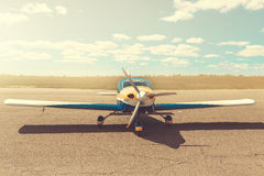 Propeller plane parking at the airport. Sunny day royalty free stock photo