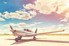 Propeller plane parking at the airport. Sunny day royalty free stock photography