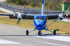 Propeller plane on runway. Twin engined propeller plane DeHavilland Twin Otter turning of the runway on St. Barth airport Stock Images