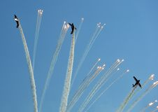 Propeller planes firing flares during an air show Royalty Free Stock Image