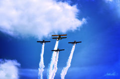 Propeller planes skywriting at an airshow Royalty Free Stock Photos