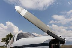 Propeller small sport aircraft, detail on propeller blade. Small modern business or personal airplane for fast transportation. On runway royalty free stock image