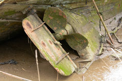 Propellor of decaying boat in mud Royalty Free Stock Photography