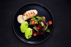 Proper nutrition, baked chicken and fresh salad royalty free stock images