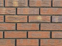 Proper tegelstenvägg med en enkel design på tegelstenarna Bekläda beskådar Royaltyfria Bilder