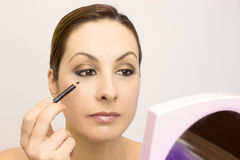 The proper way to apply makeup Royalty Free Stock Images
