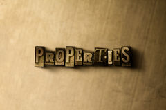 PROPERTIES - close-up of grungy vintage typeset word on metal backdrop Royalty Free Stock Image