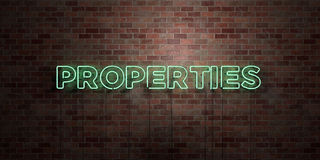 PROPERTIES - fluorescent Neon tube Sign on brickwork - Front view - 3D rendered royalty free stock picture. Can be used for online banner ads and direct Royalty Free Stock Photos