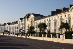 Property. Rows of terraced property against blue sky stock images