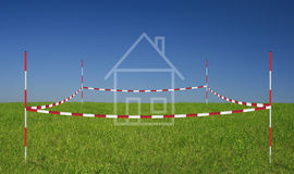 Property. On a meadow with blue sky Stock Photos