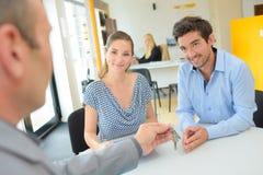 Property agent giving key. Property agent giving the key Royalty Free Stock Image