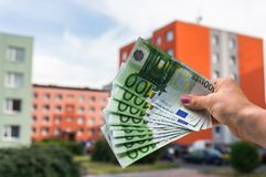 Property buyer holding euro banknotes and buying beautiful flat Royalty Free Stock Image