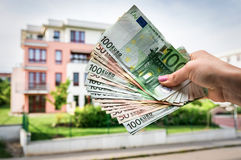 Property buyer holding euro banknotes - real estate concept Stock Images