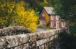 Property in Cumbrian countryside. Lanercost, UK - October 30, 2016: Rural properties and old stone bridge in Cumbria near Lanercost Priory Stock Photo