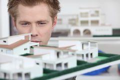 Property developer inspecting model Royalty Free Stock Photo