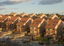 Property Development. New Housing road on a hill. Evening stock photography