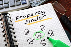 Property finder. Notebook with  property finder sign on a table. Business concept Stock Photography