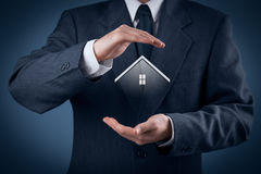 Property insurance. And security concept. Protecting gesture of man and symbol of house Stock Photo
