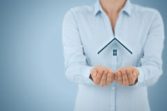 Property insurance. And security concept. Protecting gesture of man and symbol of house Stock Images