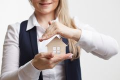 Property insurance and security concept.Real estate agent offer. House Stock Photo