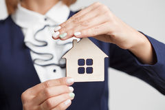 Property insurance and security concept.Real estate agent offer house.  Stock Images
