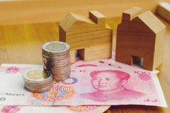 Property investment concept in China. High inflation in recent years. Financial property investment in and house mortgage in China concept. stacks of coins stock photo