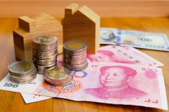 Property investment concept in China. High inflation in recent years. Financial property investment in and house mortgage in China concept. stacks of coins stock photography