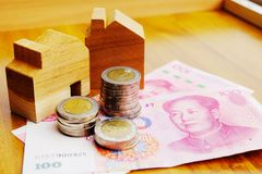 Property investment concept in China. High inflation in recent years. Financial property investment in and house mortgage in China concept. stacks of coins stock photos