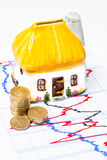 Property Investment Concept. Money Box House, Coins and Business Graph Royalty Free Stock Photo
