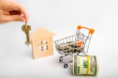 Property investment and house mortgage financial concept. buying, renting and selling apartments. real estate. keys, dollars, wood stock image
