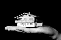 Property market. A man is holding a house in his hand Royalty Free Stock Photo