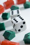 Property Market. Two dice surrounded by toy houses show double sixes (shallow depth of field used Royalty Free Stock Photo