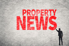 Property News. Asian business man write words on wall, Property News Royalty Free Stock Image
