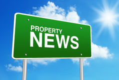 Property News. Green road sign with text Property News is in front of the blue sunny background Stock Photo