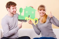 Cheerful couple holding cutouts. Royalty Free Stock Photo