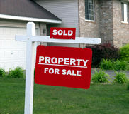 Property for Sale. A real estate sign marked as sold Stock Image
