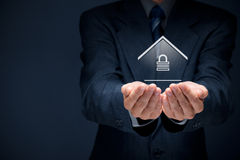 Property security. And insurance concept. Offering gesture of man and symbol of house with padlock Stock Image
