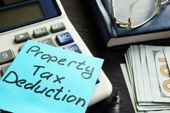 Property tax deduction written on a label. Property tax deduction written on the label stock image