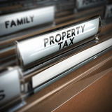Property Tax. Files with the text property tax written on the tab, close up and blur effect. Realistic 3D render Stock Photo
