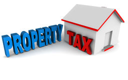 Property tax. Property or house tax concept with words next to model of a house building Royalty Free Stock Photos
