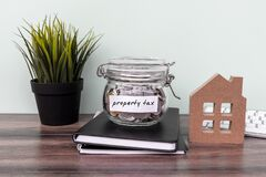 Free Property Tax Label On Coin Jar Royalty Free Stock Images - 169893519