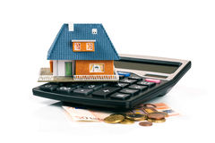 Property tax and mortgage concept - house model on calculator. With euro money Stock Photography