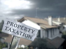 Property taxation. Home ownership concept Royalty Free Stock Images
