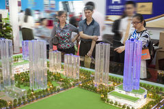 Property trade fair. Customers check out a new Chinese real estate development at a property trade fair in Liuzhou, China royalty free stock image