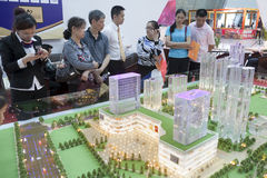 Property trade fair. Customers check out a new Chinese real estate development at a property trade fair in Liuzhou, China royalty free stock photos