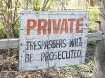 Property Warning Sign. A private property warning sign that indicates prosecution for trespassers Stock Photos