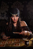 Prophetess woman with cards. Fortune teller woman working with cards Stock Photos