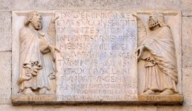 The prophets Enoch and Elijah. Hold the epigraph with the foundation date of the temple and the name of Wiligelmo, Modena Cathedral, Italy Stock Image