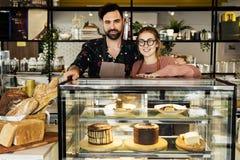 Propietarios de negocio del café de la torta pequeños fotografía de archivo libre de regalías