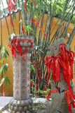 Propitious symbols,Chinese temple. Red wish ribbon tied to zen stone in Chinese temple stock photos